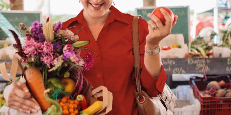 Woman smiling at food market