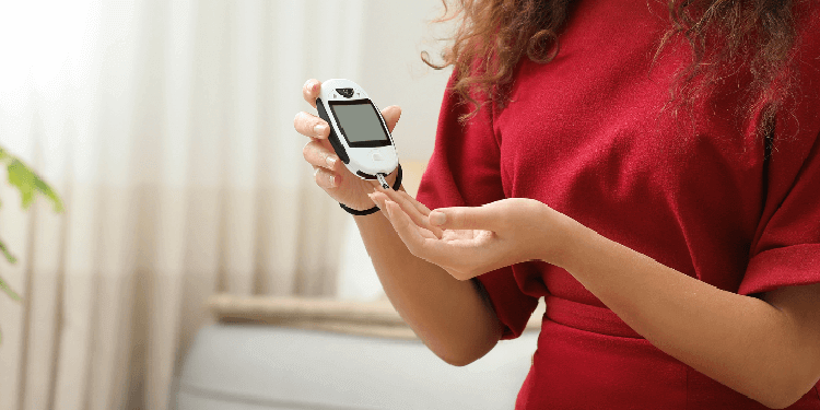 Young woman controlling diabetes and using digital glucometer at home.jpg